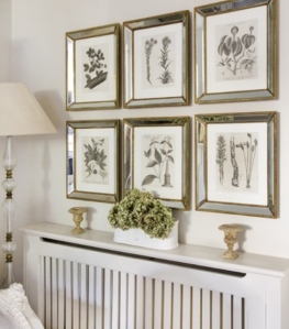 Or make it a feature wall and either do something similar or replace the pictures to black and white family Photo's!